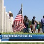 Hundreds of volunteers lay flags at Rio Grande Valley Veterans Cemetery