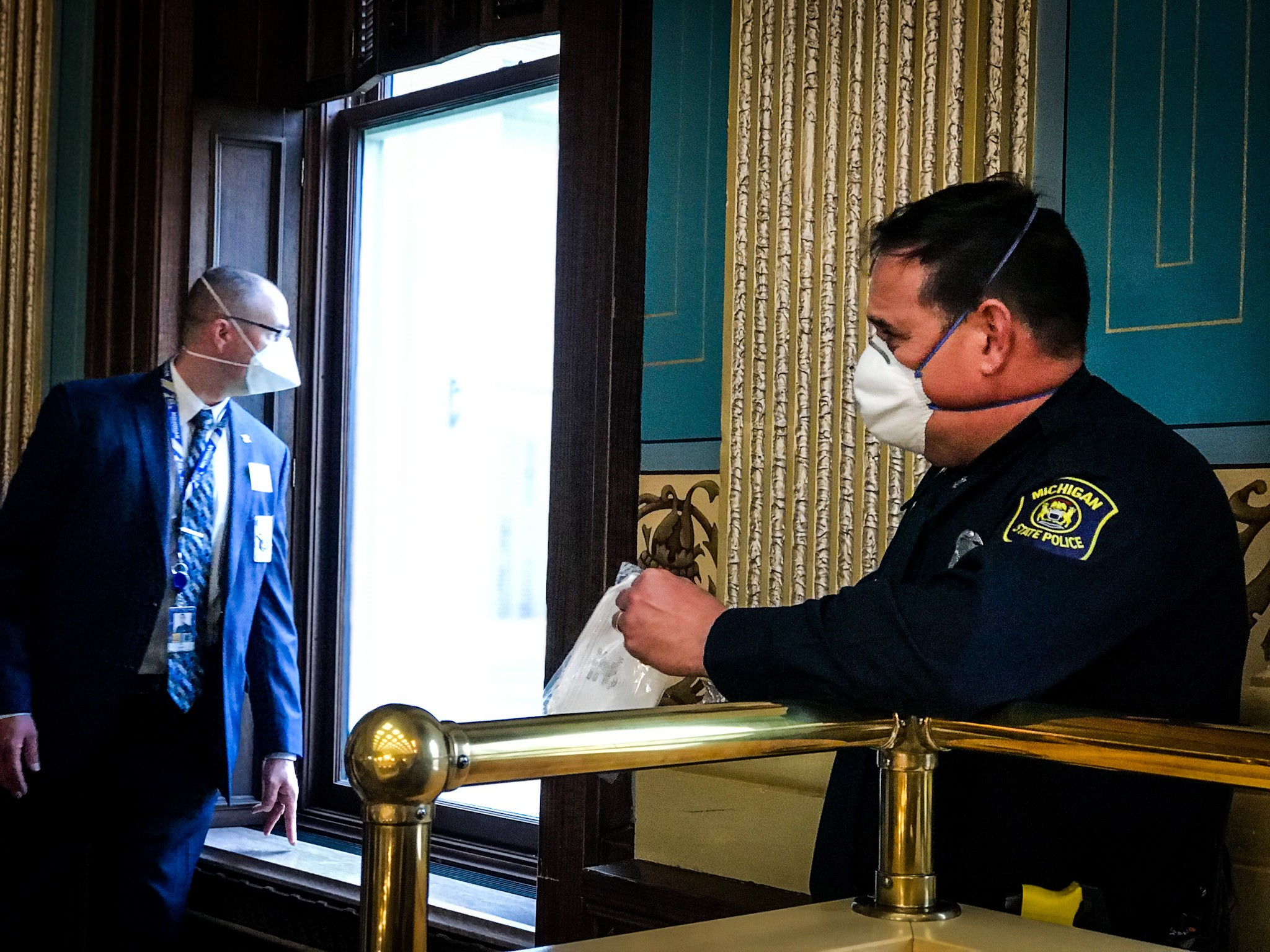 A state trooper wears a mask{ }at the Michigan Capitol on Tuesday, April 7, 2020. (SBG/Mikenzie Frost)