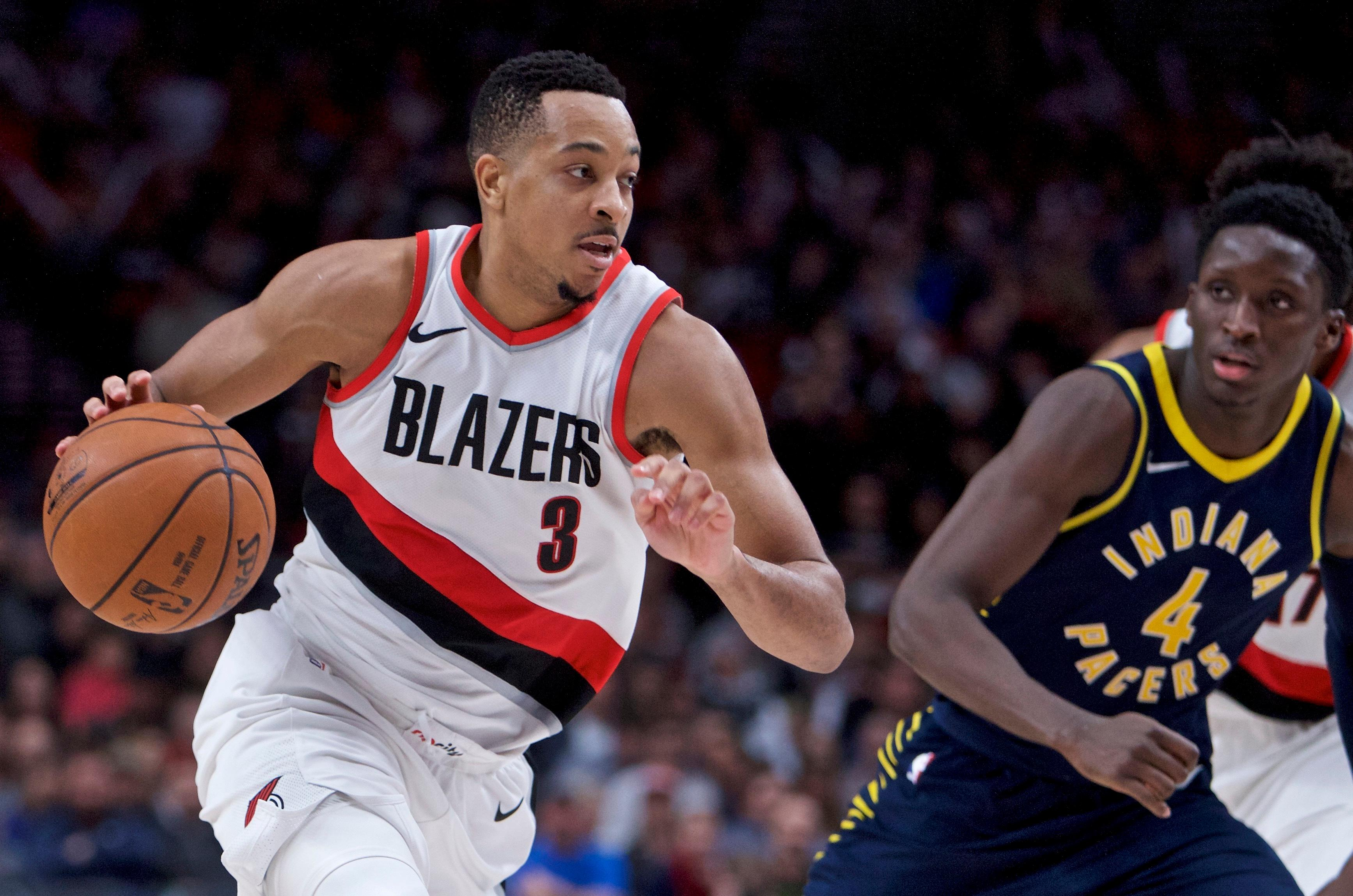 Portland Trail Blazers guard CJ McCollum drives as Indiana Pacers guard Victor Oladipo defends during the second half of an NBA basketball game in Portland, Ore., Thursday, Jan. 18, 2018. The Trail Blazers won 100-86. (AP Photo/Craig Mitchelldyer)