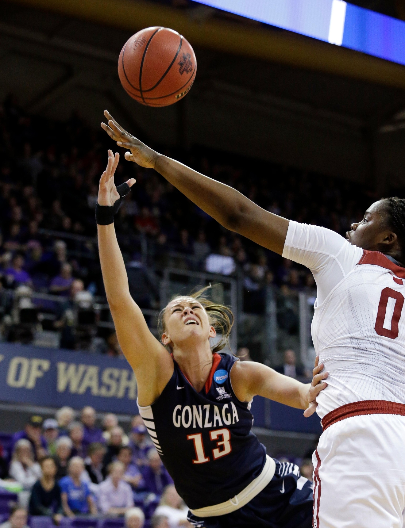 Gonzaga's Jill Barta (13) tries to get a shot past Oklahoma's Vionise Pierre-Louis during the first half of a first-round game in the NCAA women's college basketball tournament Saturday, March 18, 2017, in Seattle. (AP Photo/Elaine Thompson)