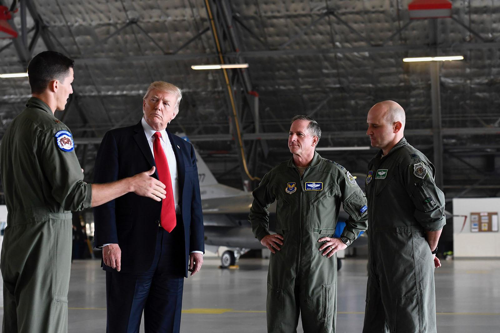 "Maj. Matt ""Fitty"" Tucker, left, describes aspects of the F-35A Lightning II with President Donald Trump, along with Air Force Chief of Staff Gen. David Goldfein and Lt. Col. Nick ""Miles"" Edwards during the Chief's ""Air Power Demonstration,"" designed to discuss key points regarding current and future national defense requirements Sept. 15, 2017, on Joint Base Andrews, Md.  Tucker and Edwards are from the 58th Fighter Squadron, Eglin Air Force Base, Fla.  (U.S. Air Force photo/Scott M. Ash)"