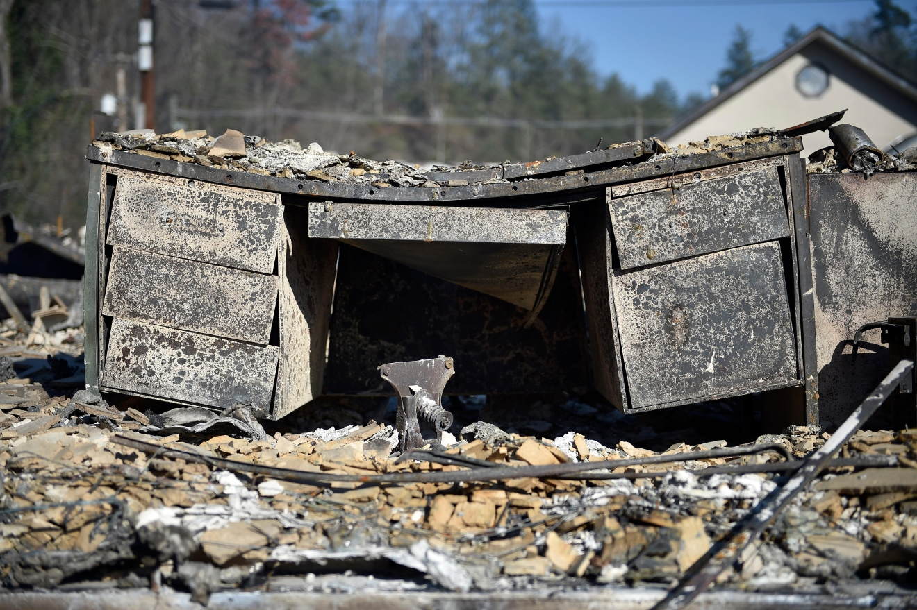 A melted desk rests inside a destroyed building, Tuesday, Nov. 29, 2016, in Gatlinburg, Tenn., after a wildfire swept through the area Monday. (Andrew Nelles/The Tennessean via AP)