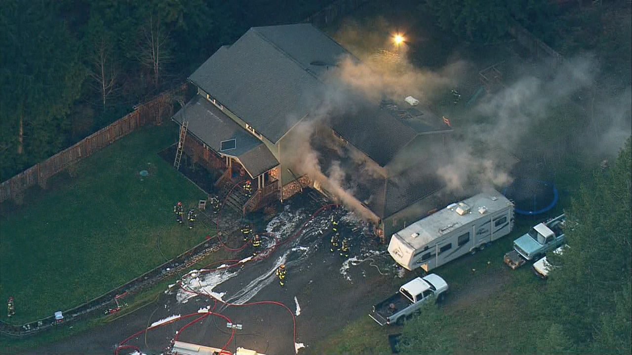 A 17-year-old boy and the family's dog managed to escape a burning home in Bremerton Monday afternoon, Jan. 22, 2018. (Photo: KOMO News/Air 4)