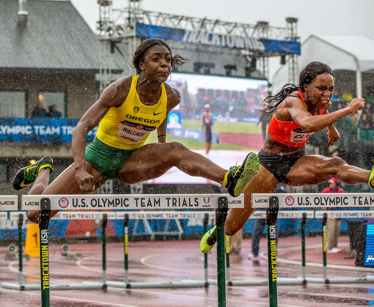Oregon's Sasha Wallace leaps hurdles in a downpour. Wallace finished seventh in her heat of the 100 meter hurdles with a time of 13.40. Photo by August Frank, Oregon News Lab