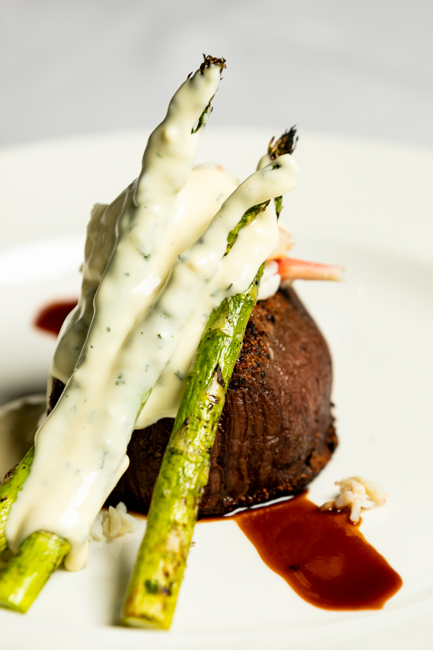 Filet Mignon Oscar Style: chef's hand-cut style, nine oz. beef tenderloin, Alaskan king crab, fresh asparagus, topped with Bearnaise sauce / Image: Amy Elisabeth Spasoff // Published: 12.30.18