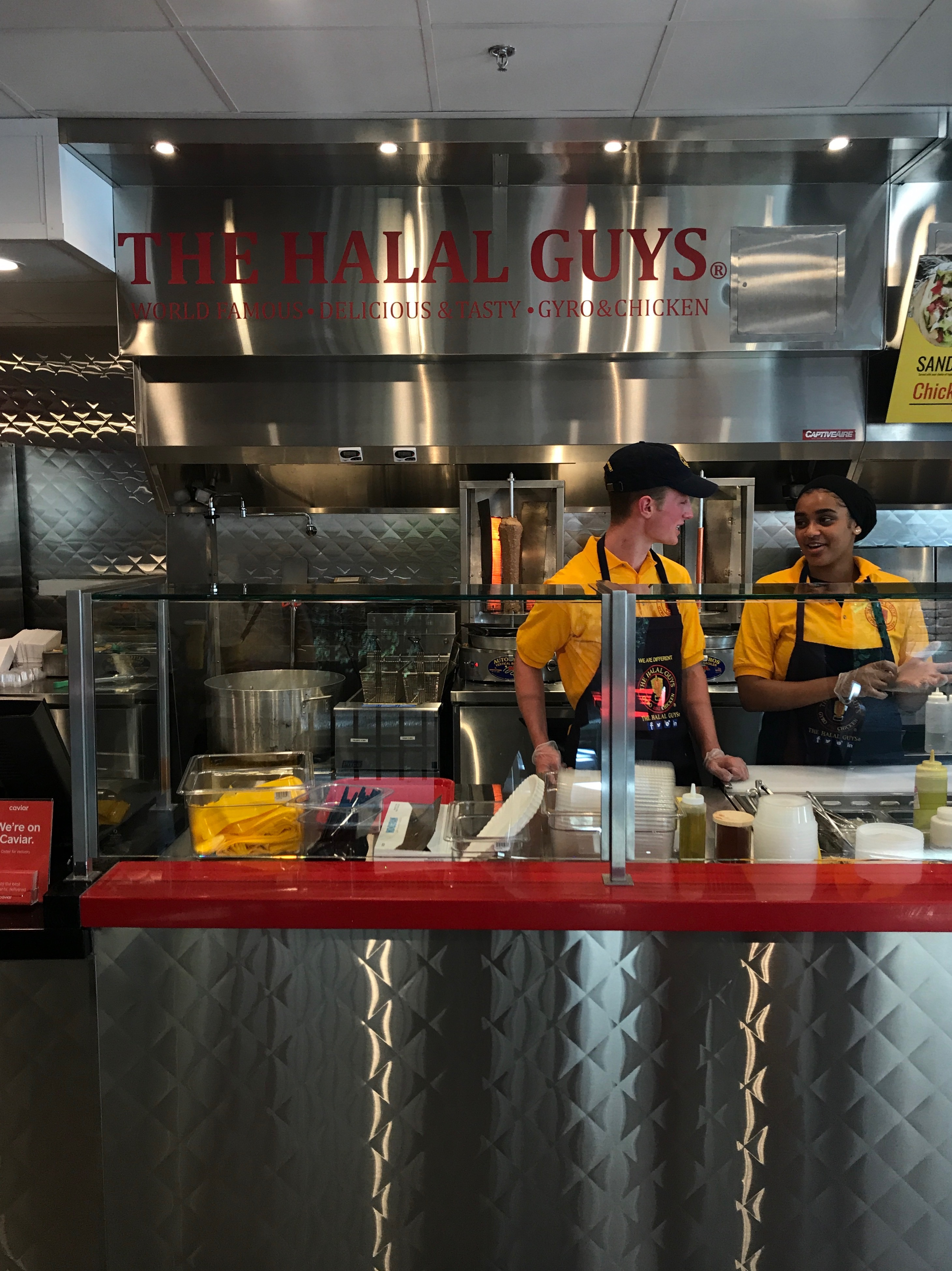 Ready to serve up platters and sandwiches at Halal Guys. (Image: Courtney Keogh)