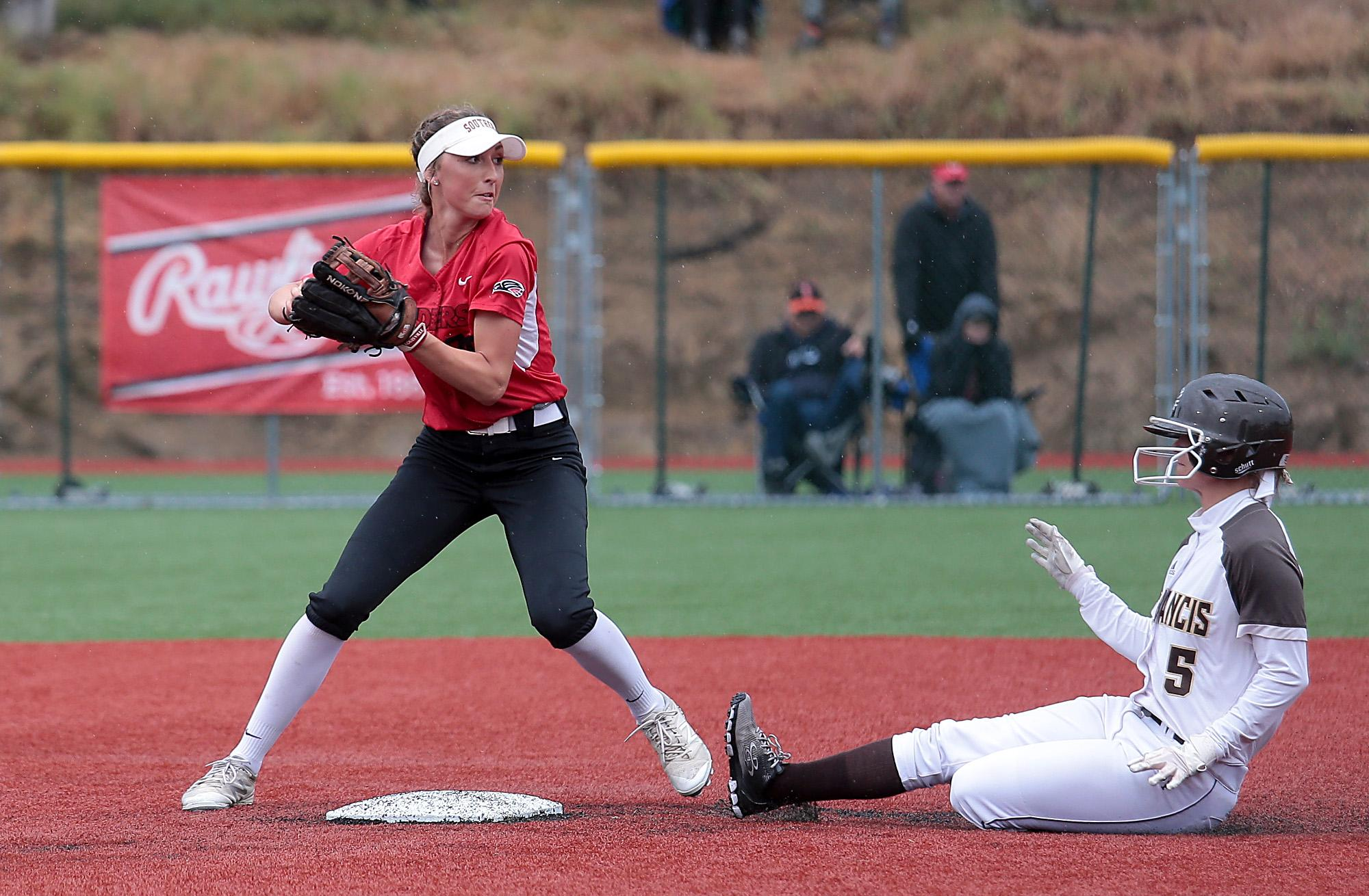 Southern Oregon University freshman Hannah Shimek looks to turn the double play over St. Francis baserunner Anna Wetherell at US Cellular Community Park on Wednesday.[PHOTO BY:  LARRY STAUTH JR]