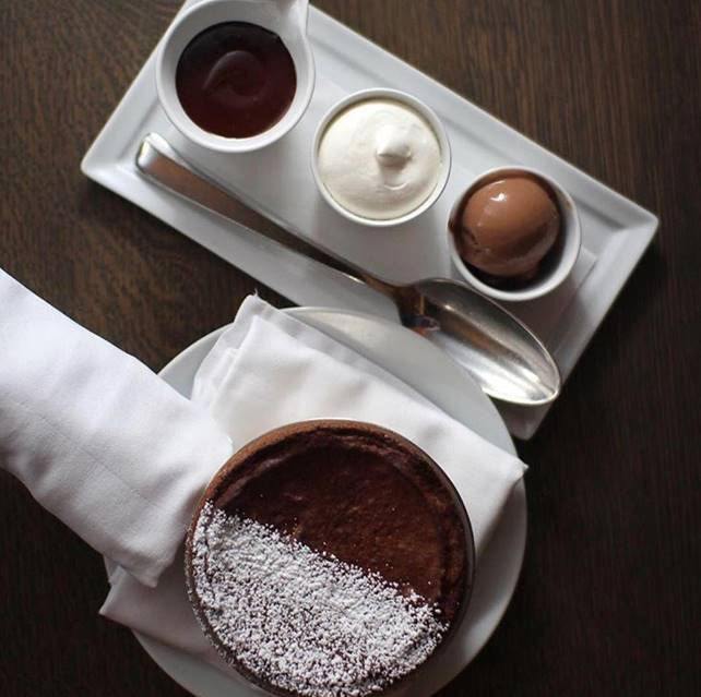 This soufflé is a triple chocolate threat. Made with Valrhona chocolate, it's served with chocolate sorbet and chocolate sauce.{ } (Image: Damon Luu)