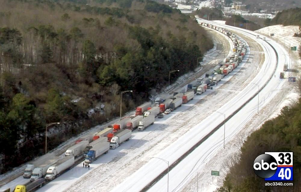Aerial photo taken from the Airlink 3340 helicopter of dozens of 18-wheelers at a standstill on I-20 East in Birmingham, Ala, Wednesday, January 29, 2014.