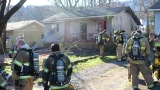 Chattanooga firefighters pull woman from burning home
