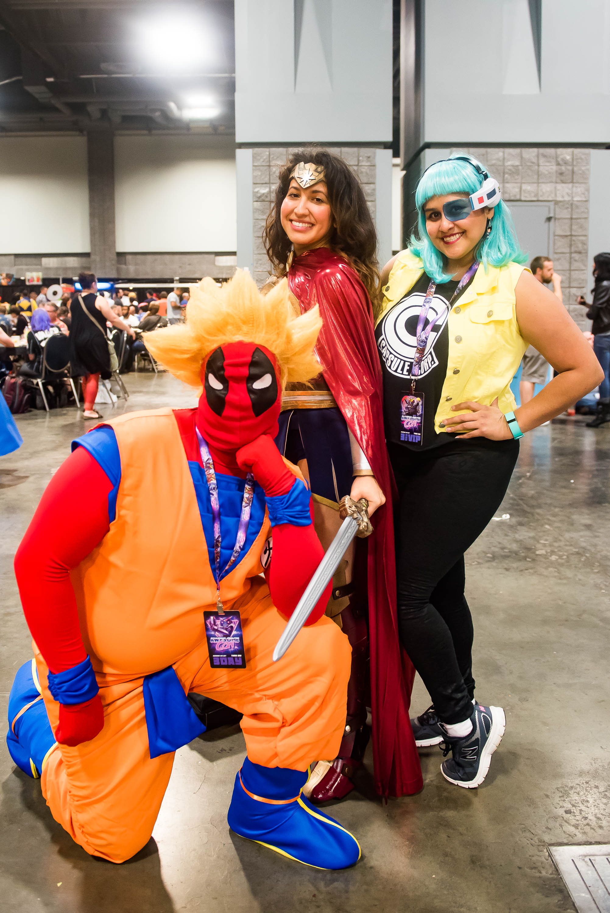 "Day 2 of Awesome Con saw even more superheroes and their superfans as they took over the Convention Center. Guests attended sessions such as ""Love Your Cosplay Body""shopped for more comic paraphernalia from the vendors and waited   in line for autographs from their favorite characters. We heard there was even a secret wedding between Deadpool and Wonder Woman! (Image: Joy Asico/www.asicophoto.com)"