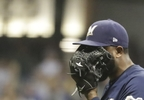 Milwaukee Brewers relief pitcher Jeremy Jeffress reacts after giving up a run during the ninth inning against the Chicago Cubs Thursday, Sept. 21, 2017, in Milwaukee.