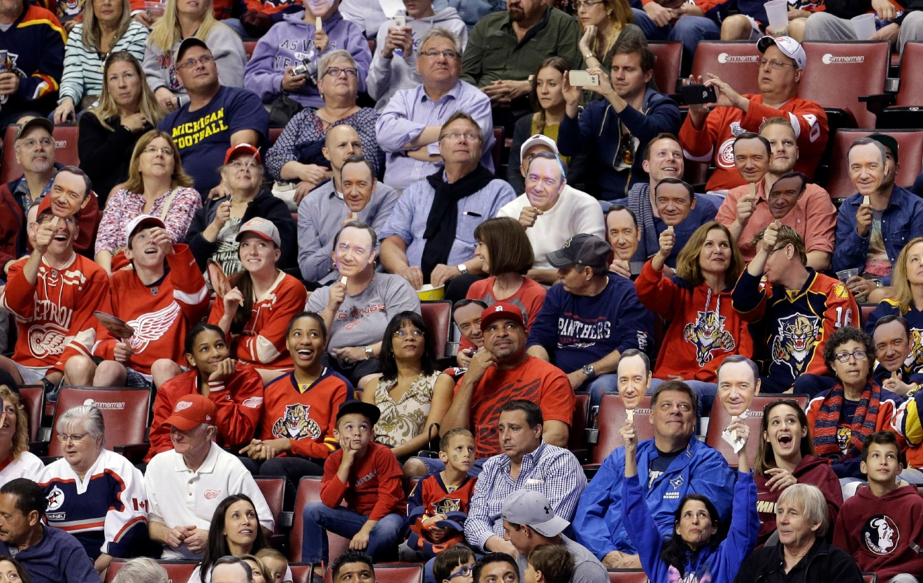 Fans show their Kevin Spacey masks before the NHL hockey game between the and the Detroit Red Wings in Sunrise, Fla., Saturday, March 19, 2016. (AP Photo/Alan Diaz)