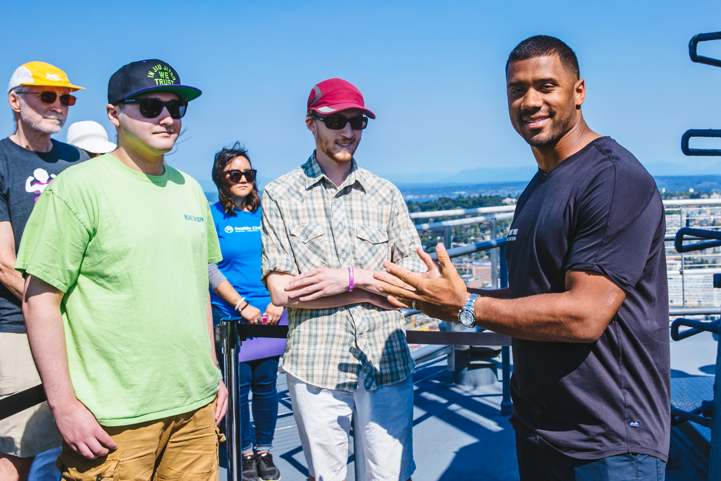 "Seahawks quarterback Russell Wilson raised the ""Strong Against Cancer"" flag on top of the Space Needle on Sunday, August 27 2017 to kick of Childhood Cancer Awareness Month, which is September. Wilson is Strong Against Cancer's Team Captain through his Why Not You Foundation, whose philanthropic efforts aim to put an end to pediatric cancer with the support of the community. More than 10,000 children in the U.S. will be diagnosed with cancer this year, yet pediatric cancers receive less than 3% of the National Cancer Institute budget for research. (Image: Sunita Martini / Seattle Refined)"
