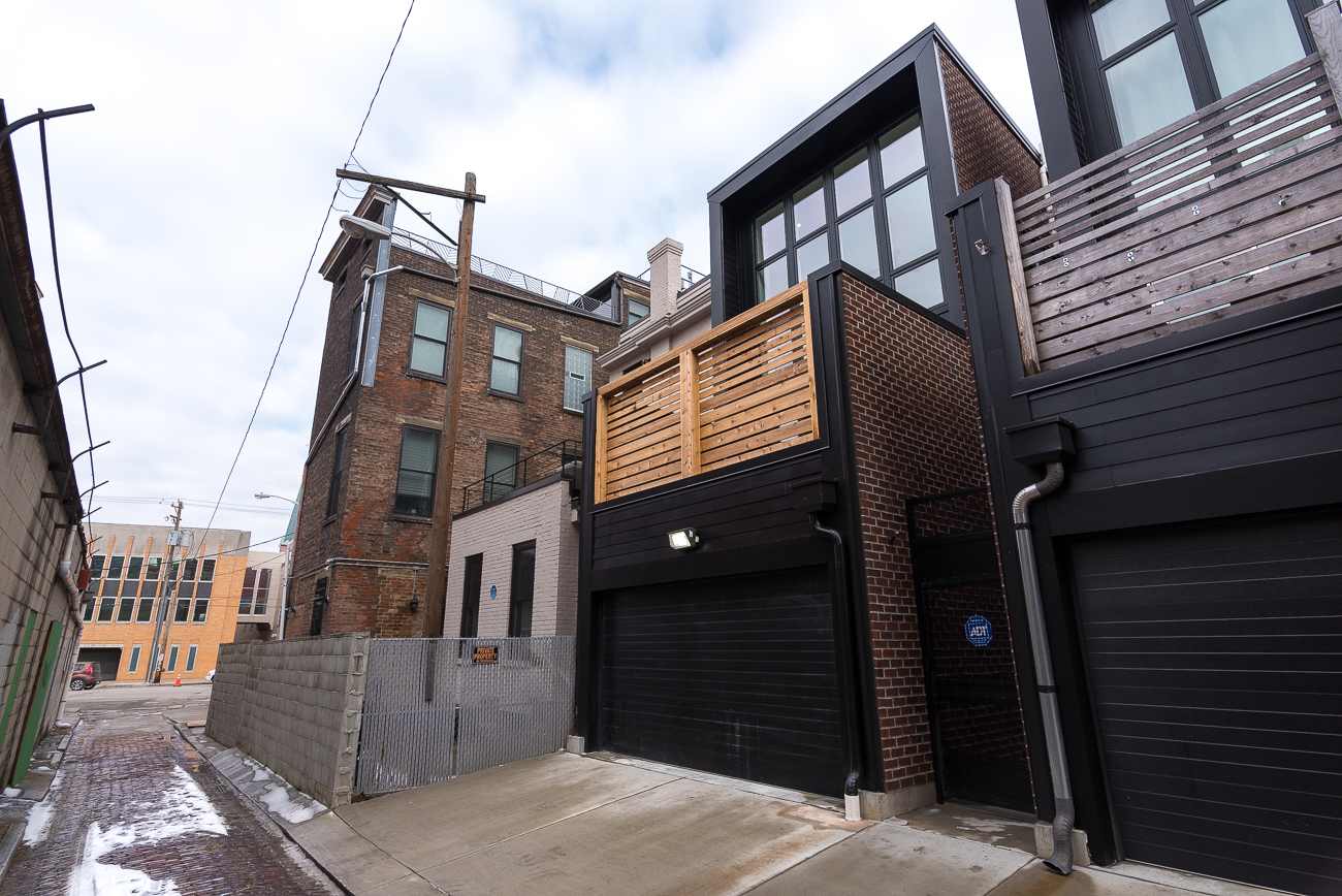 Access to the spacious garage is in a brick-lined alley behind 1533 Republic Street. / Image: Phil Armstrong, Cincinnati Refined // Published: 2.4.19