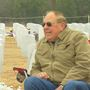 Man sits beside wife's grave, every day, rain or shine