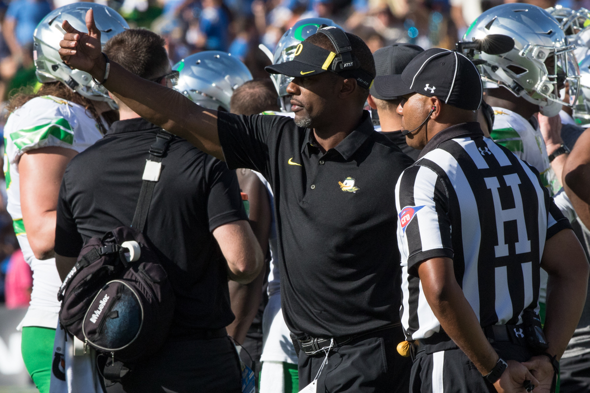 Oregon head coach Willie Taggart calls the refs over after disagreeing with a call. The Oregon Ducks fell to the UCLA Bruins 14-31 after being shut out during the second half at the Rose Bowl Stadium in Pasadena, California.  This marks the third consecutive loss for the Ducks, dropping their record to 4-4 on the season.  Photo by Austin Hicks, Oregon News Lab