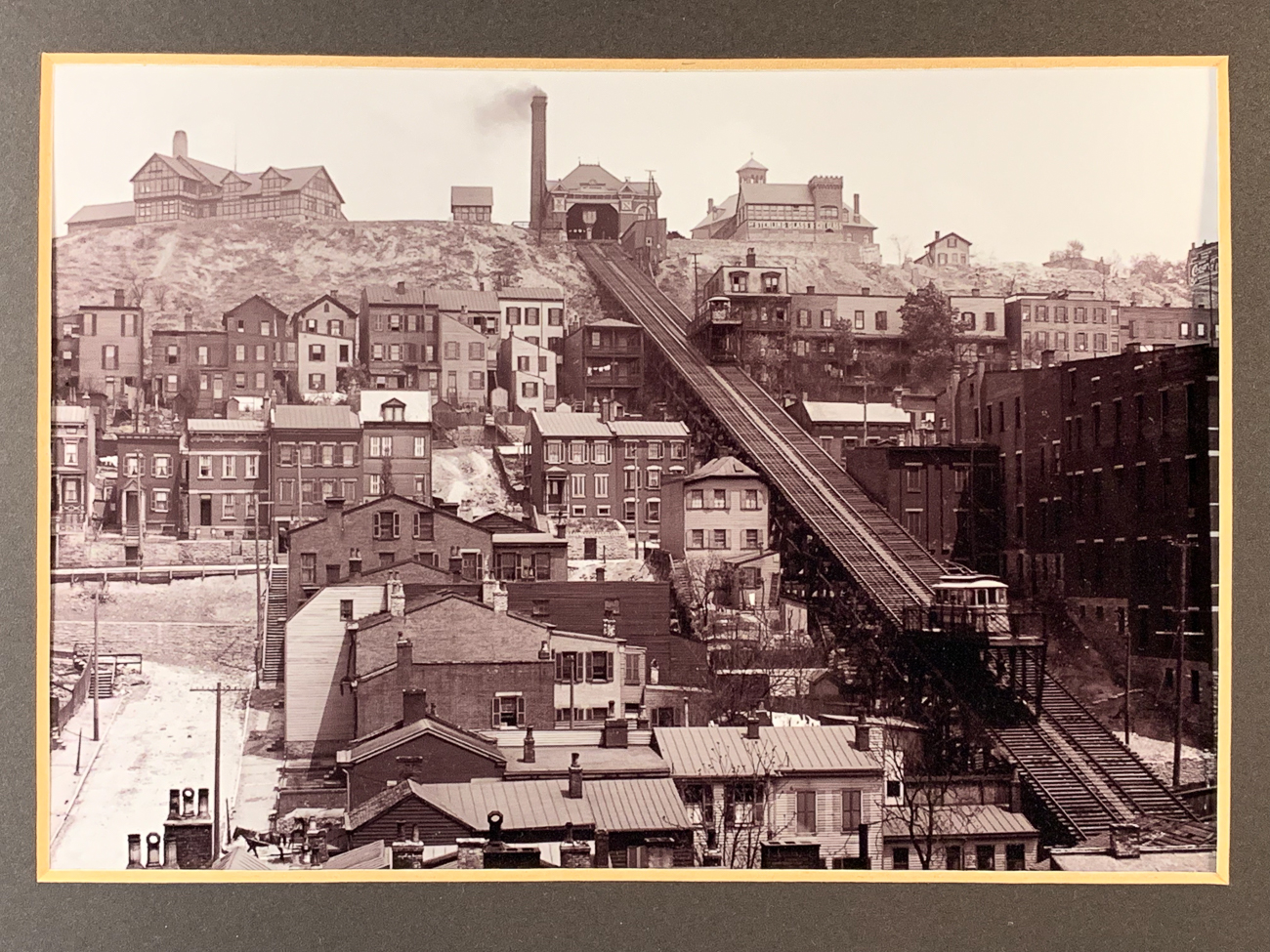 Before cars and buses began easily conquering the hills of Cincinnati, inclined planes were built to transport people from the city below to the hills above. Platforms on tracks, often times made to accept streetcars, slowly raised and lowered generations of Cincinnatians up and down steep terrain. While they no longer stand, clues as to where they were remain. / Image of Mt. Adams Incline // Published: 1.2.19