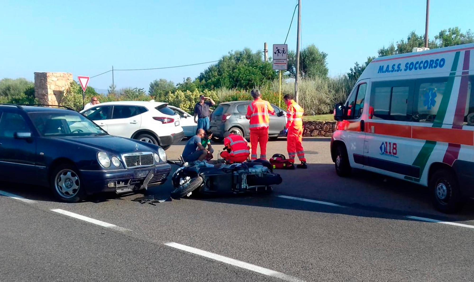 "Ambulance personnel tend to a man lying on the ground, later identified as actor George Clooney, after being involved in a scooter accident near Olbia, on the Sardinia island, Italy, Tuesday, July 10, 2018. Actor George Clooney was taken to the hospital in Sardinia on Tuesday and released after being involved in an accident while riding his motor scooter, hospital officials said. ""He is recovering at his home and will be fine,"" spokesman Stan Rosenfield told The Associated Press in an email. The John Paul II hospital in Olbia confirmed Clooney had been treated and released after Tuesday's accident. Local media that had gathered at the hospital said Clooney left in a van through a side exit. (AP Photo/Mario Chironi)"