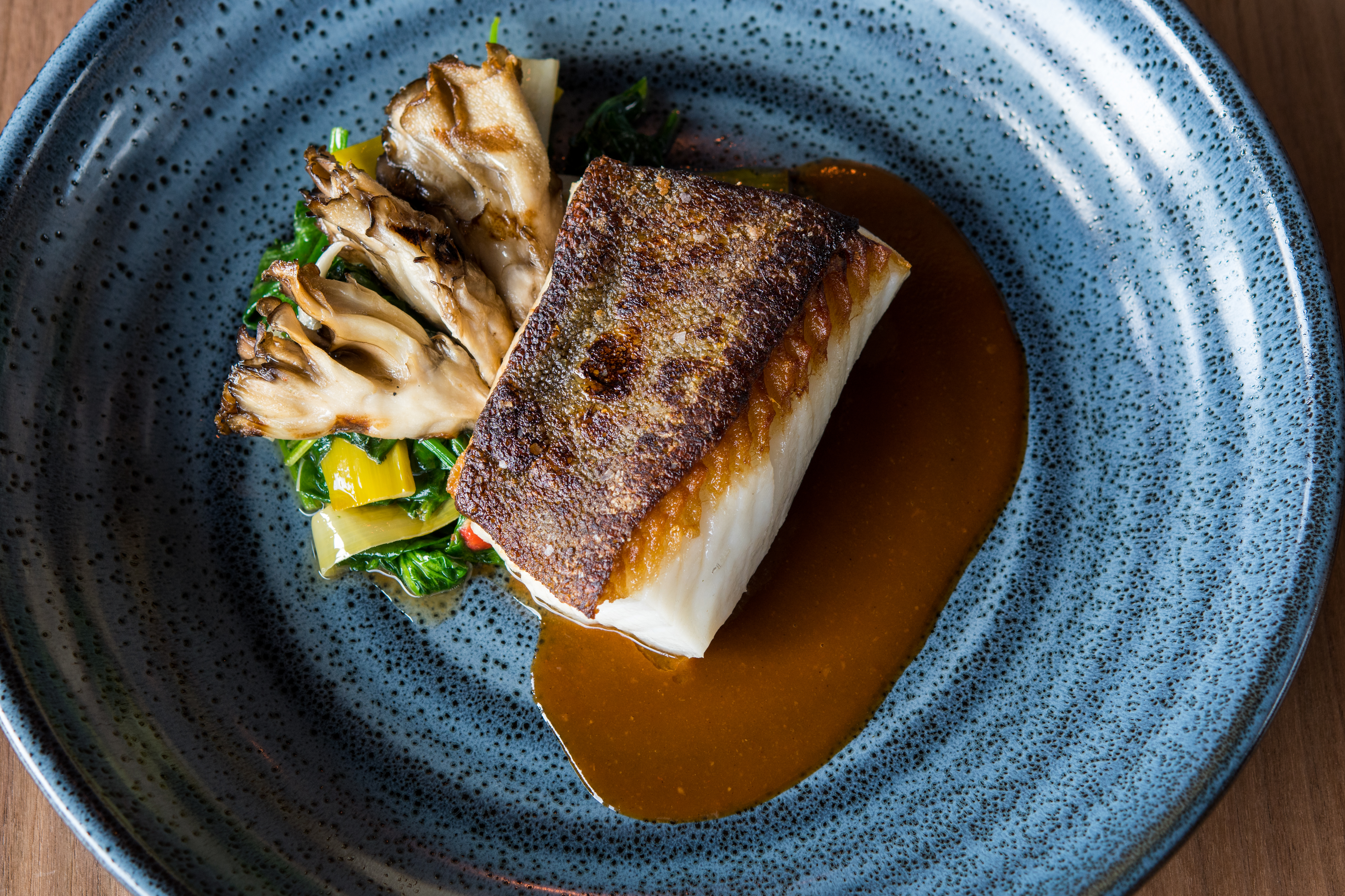Black Cod with hen of the woods mushrooms, spinach and smoked pepper sauce (Image courtesy of Fire Vine/Aerlume).