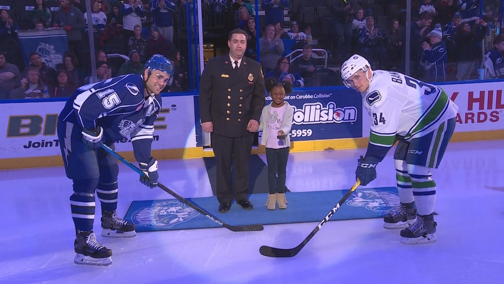 5-Year-Old Emagine drops the puck at Saturday night's Syracuse Crunch game