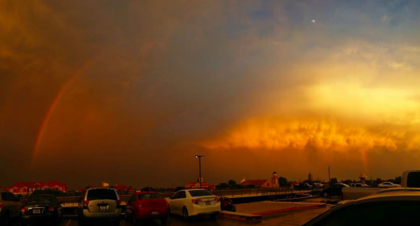 IMAGE: IG user @ moosajee / POST: Trust me this picture is real. Nofilters! Panorama of a storm exiting towards East - Northeast leaving behind beautiful sunset, rainbow, moon, stormcloud top with awesome colors and fresh winds.