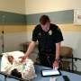 Officer takes care of baby after infant found in stolen vehicle with father