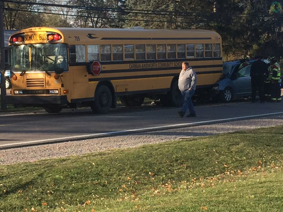 A van collided with a Carman-Ainsworth bus Friday causing some students minor injuries. (Photo: Mike/Horne/WEYI/WSMH)