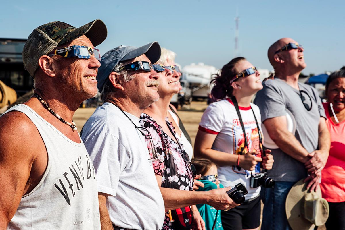 Campers watch the eclipse begin with their solar filter glasses on. Photo by Cheyenne Thorpe, Oregon News Lab