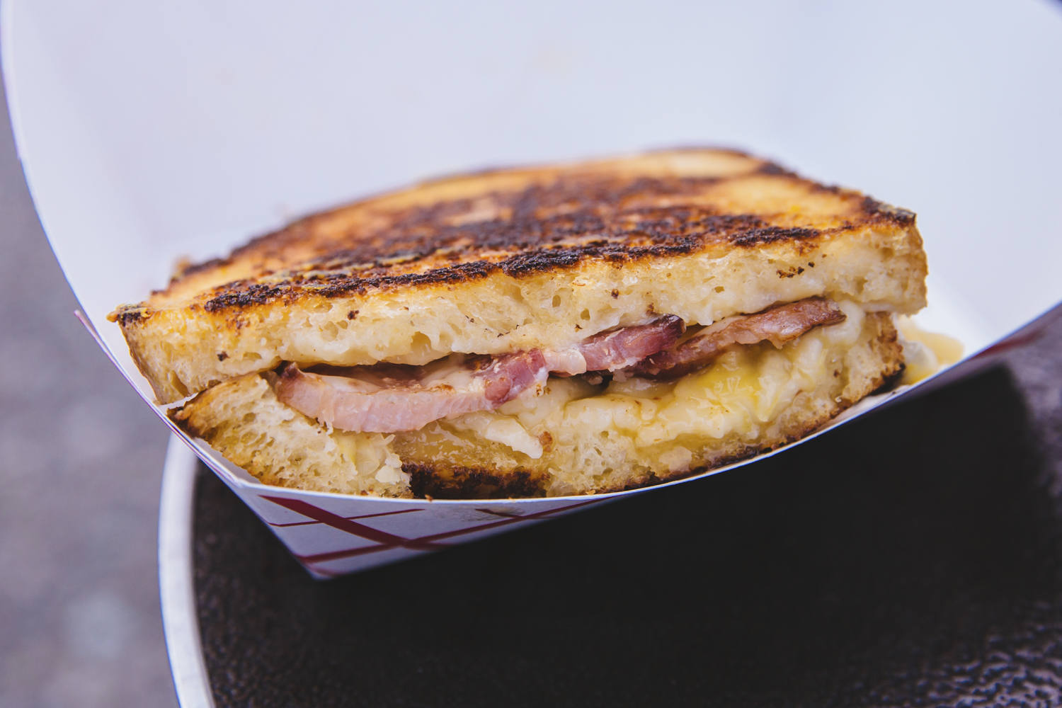 <p>&quot;On The Beech&quot;, from The Cheese Pit food truck. Beecher's Flagship Cheese, Thick sliced bacon and crushed pineapple with a citrus glaze on Seattle Sourdough. Seattle's annual Grilled Cheese Grand Prix event kicked off this weekend, properly celebrating April as National Grilled Cheese Month. We went, obviously (for work....) and here were the juiciest sammies on the block we could find. The good news? Pretty much all of these come from brick and mortar stores you can find any time in the city - not just April, and not just t the Grand Prix. (Image: Sunita Martini / Seattle Refined)</p>