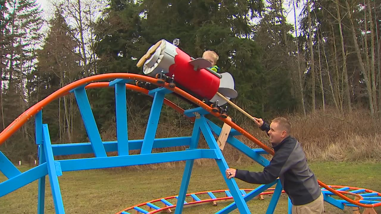 navy pilot builds roller coaster in backyard for 3 year old son wkrc