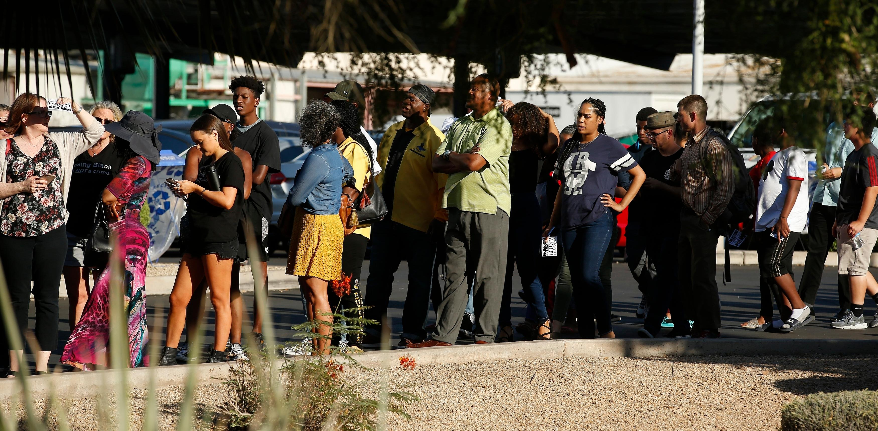 People line up to attend a community meeting, Tuesday, June 18, 2019, in Phoenix. (AP Photo/Ross D. Franklin)