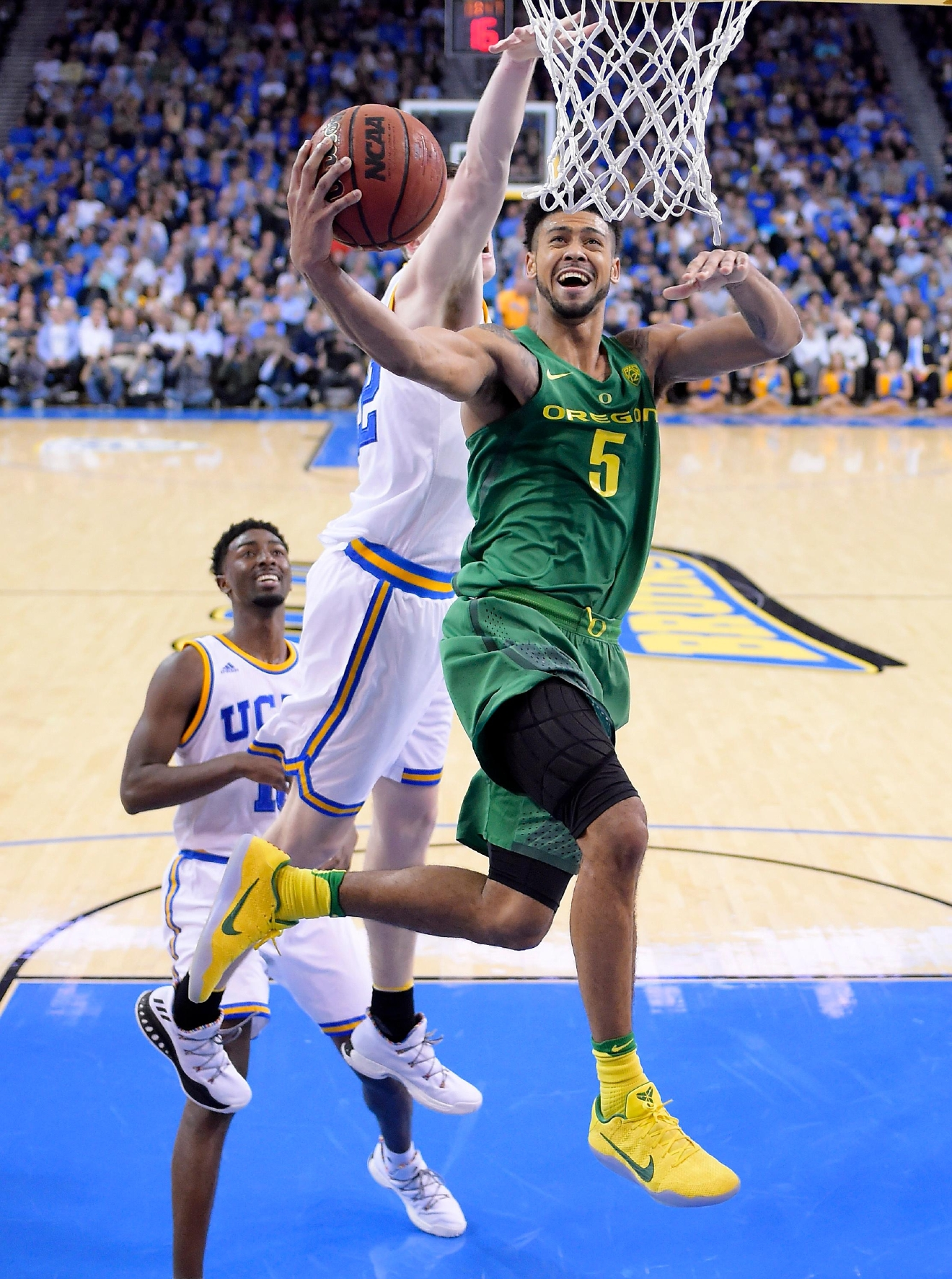Oregon guard Tyler Dorsey, right, shoots as UCLA forward TJ Leaf defends during the second half of an NCAA college basketball game, Thursday, Feb. 9, 2017, in Los Angeles. UCLA won 82-79. (AP Photo/Mark J. Terrill)