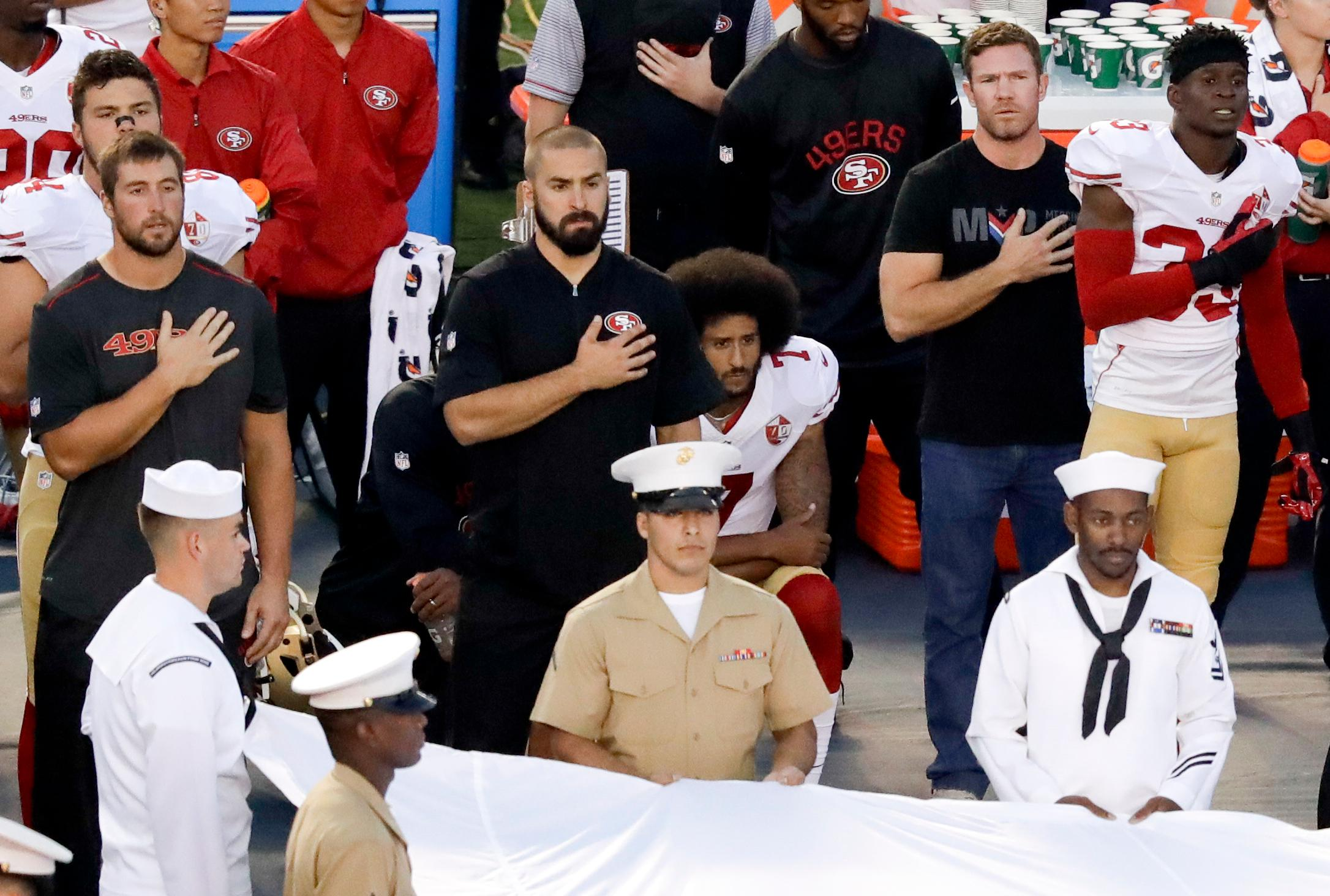 FILE - In this Sept. 1, 2016, file photo, San Francisco 49ers quarterback Colin Kaepernick, center, kneels during the National Anthem before an NFL preseason football game against the San Diego Chargers in San Diego. {&amp;nbsp;}(AP Photo/Chris Carlson, File)<p></p>