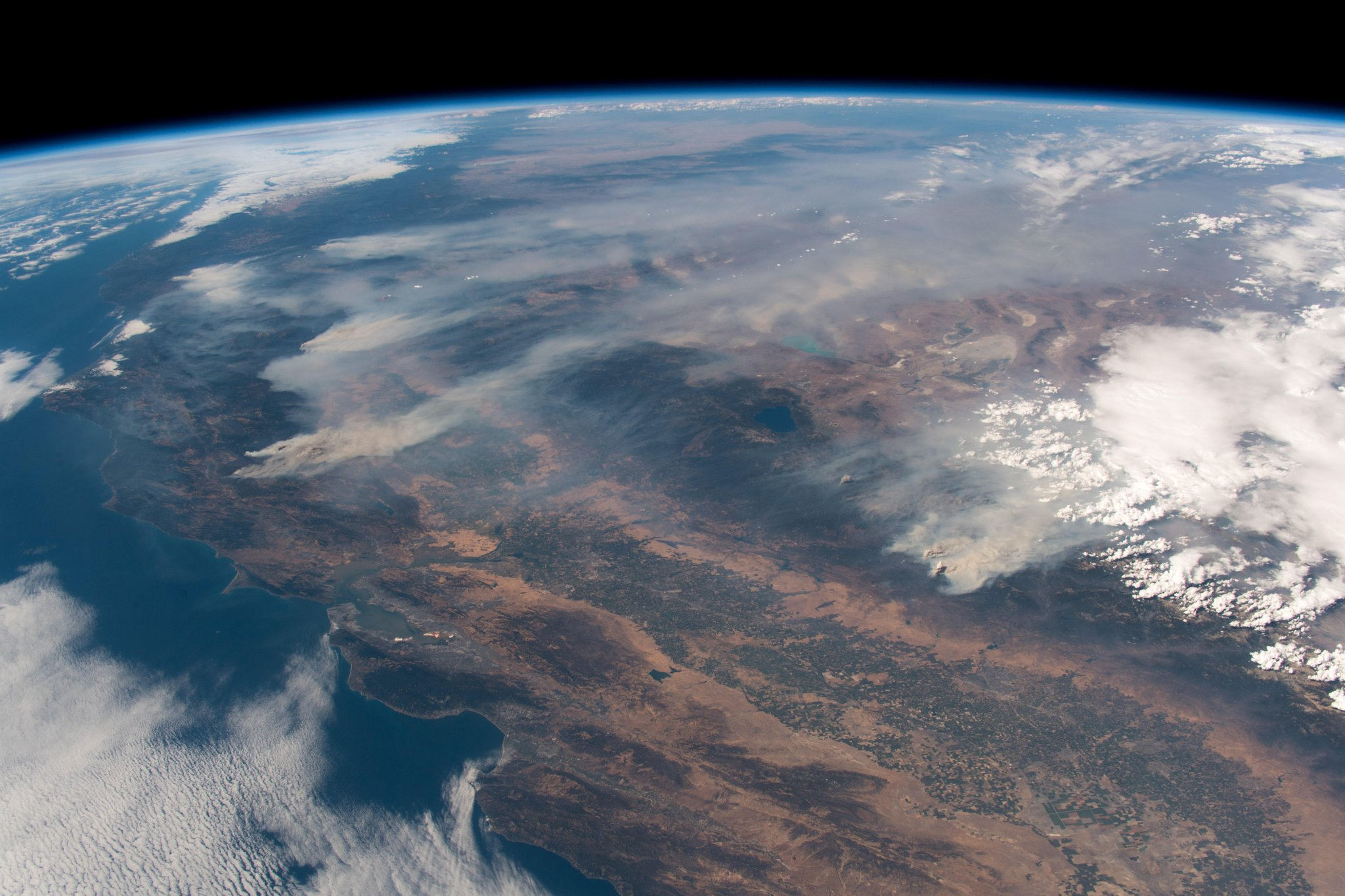 California burning. These fires are frightening to watch, even from space. Here's a shout-out from space to all firefighters on this planet, my former colleagues. Stay safe my friends! (Photo & Caption: Alexander Gerst / NASA)