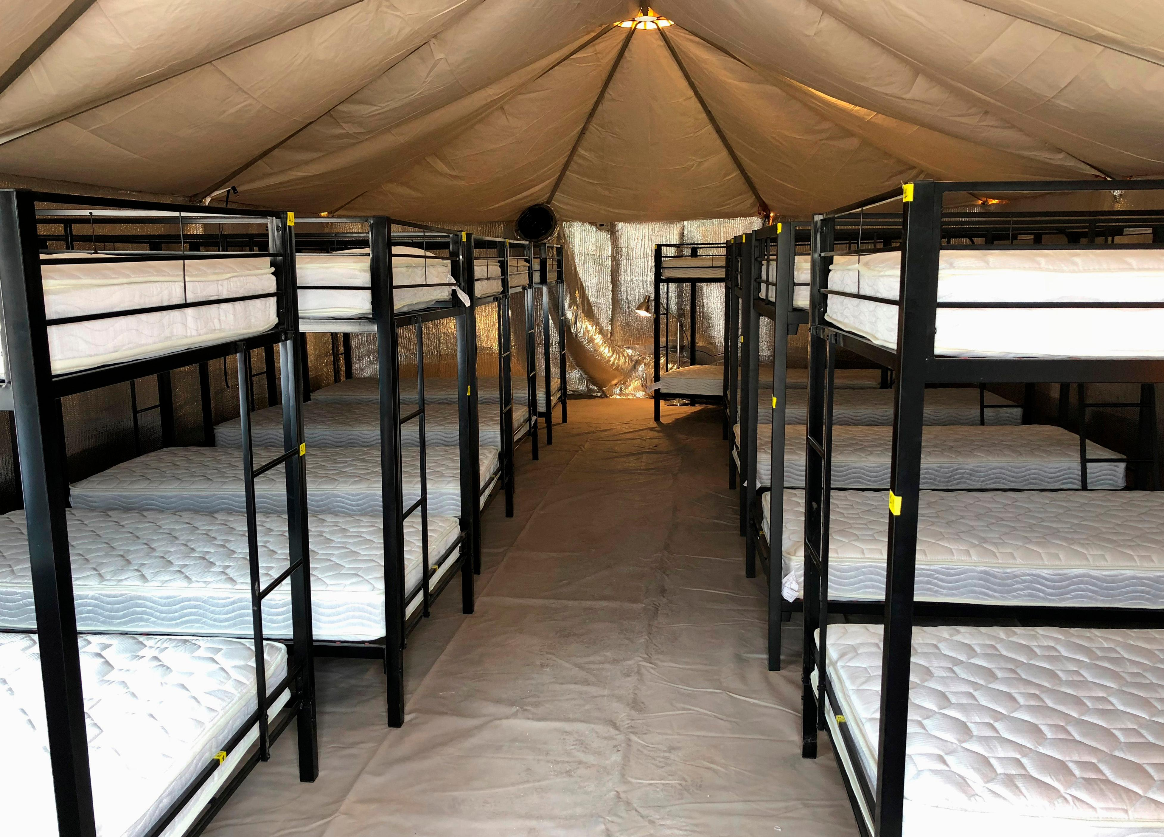 This undated photo provided by the U.S. Department of Health and Human Services' Administration for Children and Families shows beds at the shelter used to house unaccompanied foreign children in Tornillo, Texas. (HHS' Administration for Children and Families via AP)