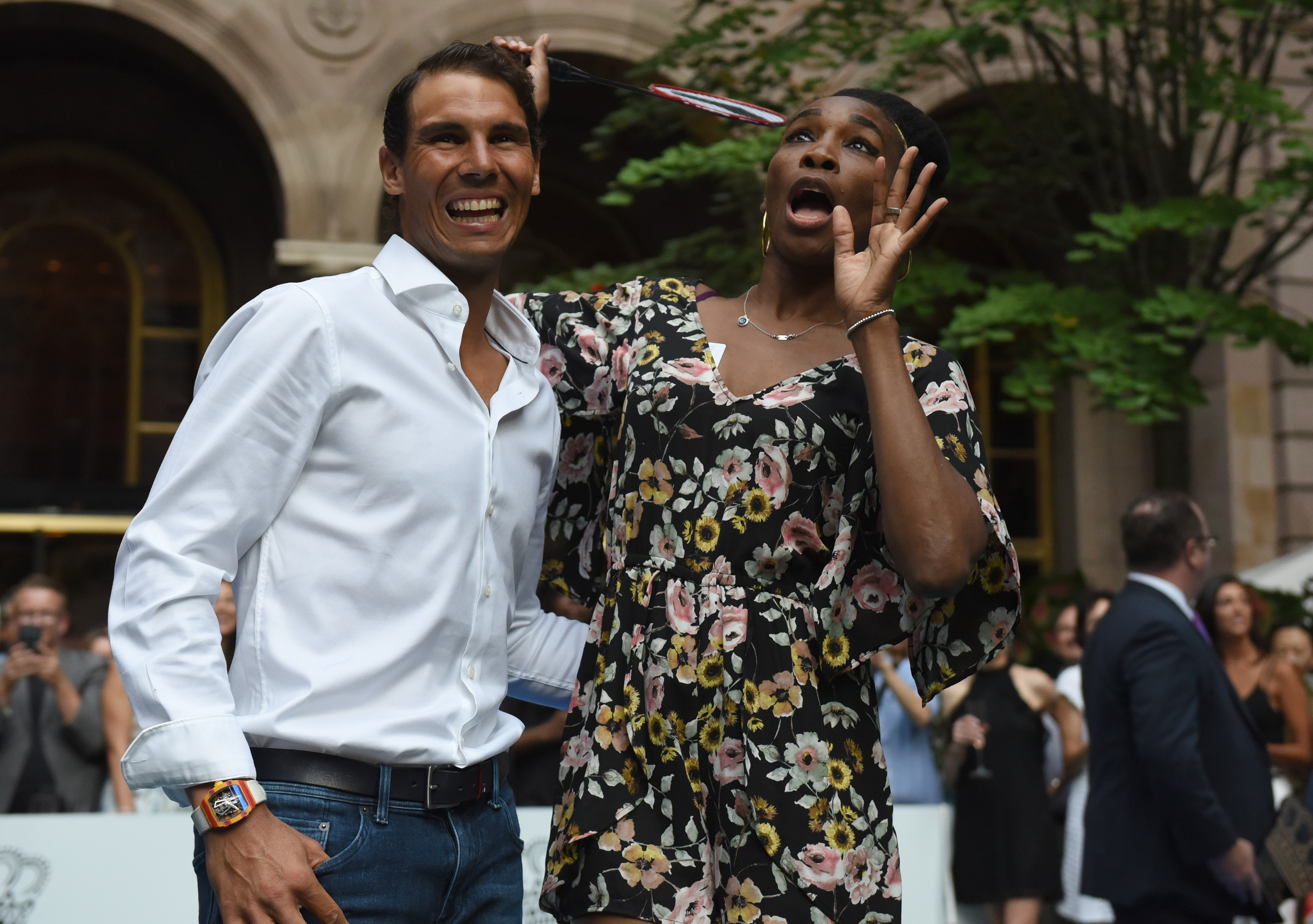 Venus Williams of the USA stands with world number one tennis player Rafael Nadal of Spain following their match in the Lotte New York Palace Invitational Badminton Tournament at the Lotte New York Palace in New York August 24, 2017. / AFP PHOTO / TIMOTHY A. CLARY        (Photo credit should read TIMOTHY A. CLARY/AFP/Getty Images)