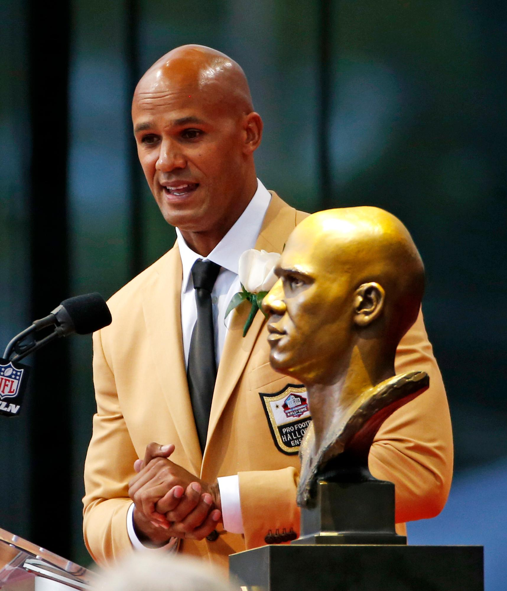 Jason Taylor speaks during his induction at the Pro Football Hall of Fame on Saturday, Aug. 5, 2017, in Canton, Ohio. (AP Photo/Gene J. Puskar)