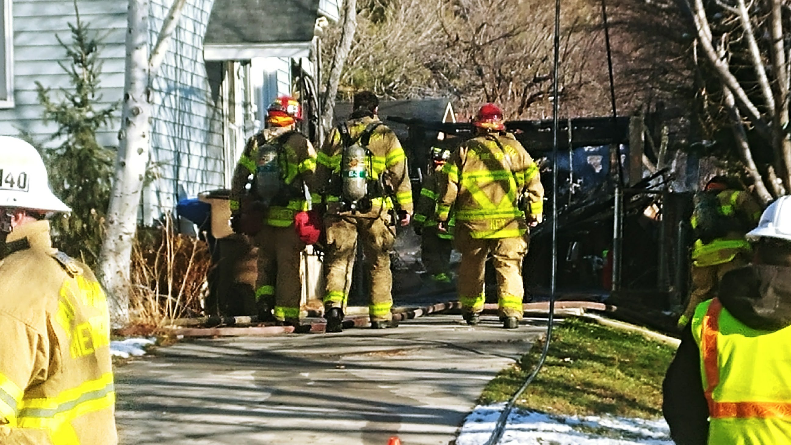 Salt Lake Firefighters work to extinguish a garage fire at a Salt Lake City residence. (Photo: Brian Morris / KUTV)<p></p>