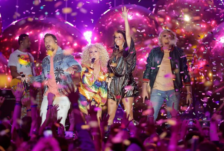 "Jimi Westbrook, from left, Kimberly Schlapman, Karen Fairchild, and Phillip Sweet, of Little Big Town, perform ""Summer Fever"" at the CMT Music Awards{ } (AP Photo/Mark Humphrey)"