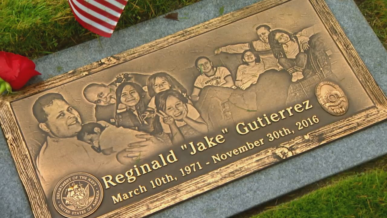 Rebecca Humphrey visits her her fiancé's memorial in Tacoma. Tacoma Police Officer Jake Gutierrez was shot and killed during a domestic violence call in November 2016. (Photo: KOMO News)