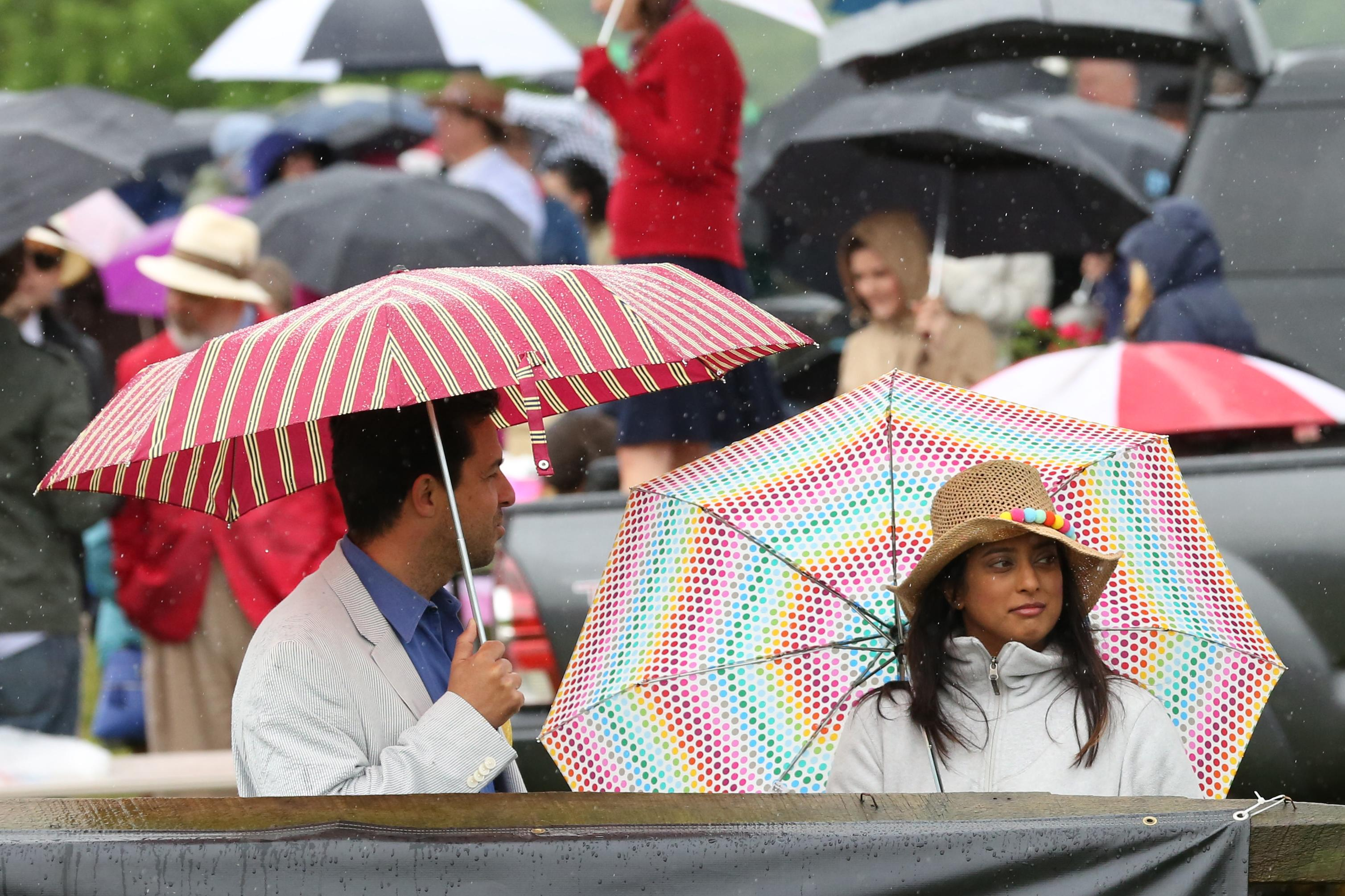 Rain and mud couldn't stop Gold Cup fans from descending on Great Meadow. The horse races enthralled audiences as guests dawned their best hats and placed their bets. (Amanda Andrade-Rhoades/DC Refined)