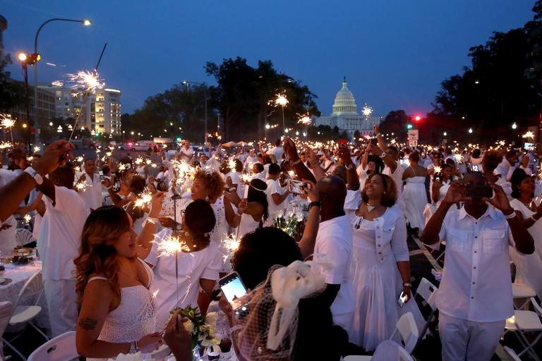 On Saturday evening, thousands of diners clad in white from head to toe will descend on a yet-undisclosed location in the D.C. area for the annual fête known as Diner en Blanc. (Image: Amanda Andrade-Rhoades/ DC Refined)