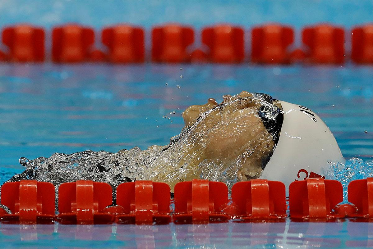 Lu Dong from China competes in the women's 100-meter backstroke S6 swimming event at the Rio 2016 Paralympic Games in Rio de Janeiro, Brazil, Thursday Sept. 8, 2016. (AP Photo/Leo Correa)