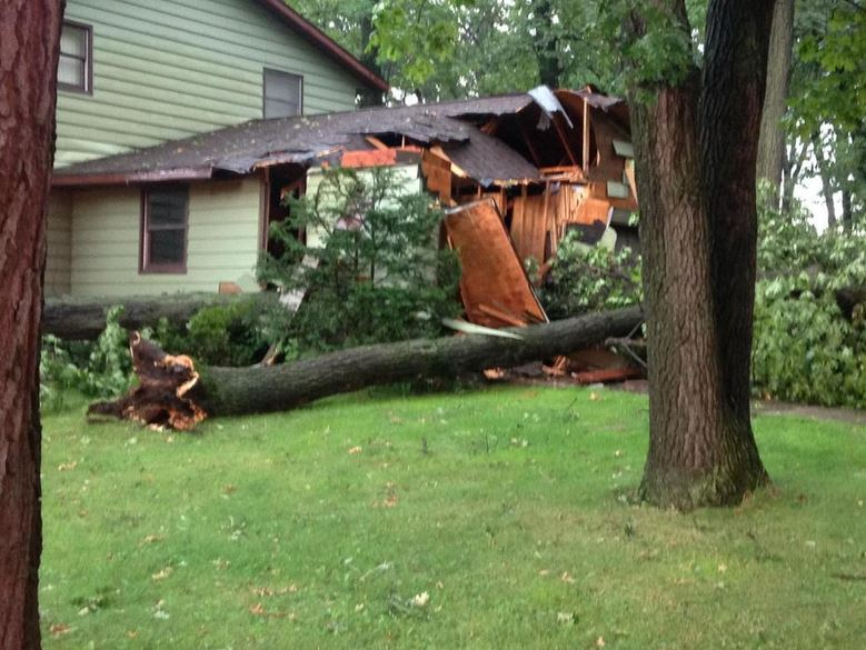 Aug. 14: A home is damaged by trees during a storm on Beech Tree Drive in Green Bay (WLUK/Ben Krumholz)