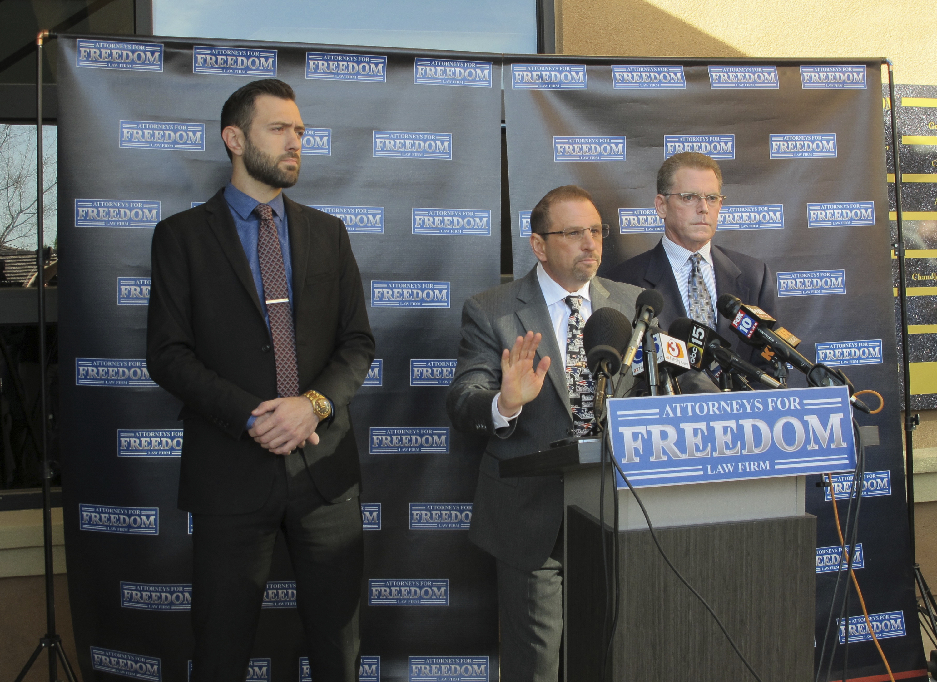 Criminal defense lawyers, Andrew Marcantel, left, and Marc Victor, middle, stand with their client, Douglas Haig, right, at a news conference in Chandler, Ariz., Friday, Feb. 2, 2018. Haig, a 55-year-old aerospace engineer who sold ammunition as a hobby for about 25 years, said he met Stephen Paddock at a Phoenix gun show in the weeks before the Oct. 1 shooting in Las Vegas that killed 58 people and injured hundreds more. Haig said he was shocked and sickened when a federal agent informed him of the massacre 11 hours after it unfolded. It's unknown whether the ammunition he sold to Paddock was used in the attack. (AP Photo/Brian Skoloff)