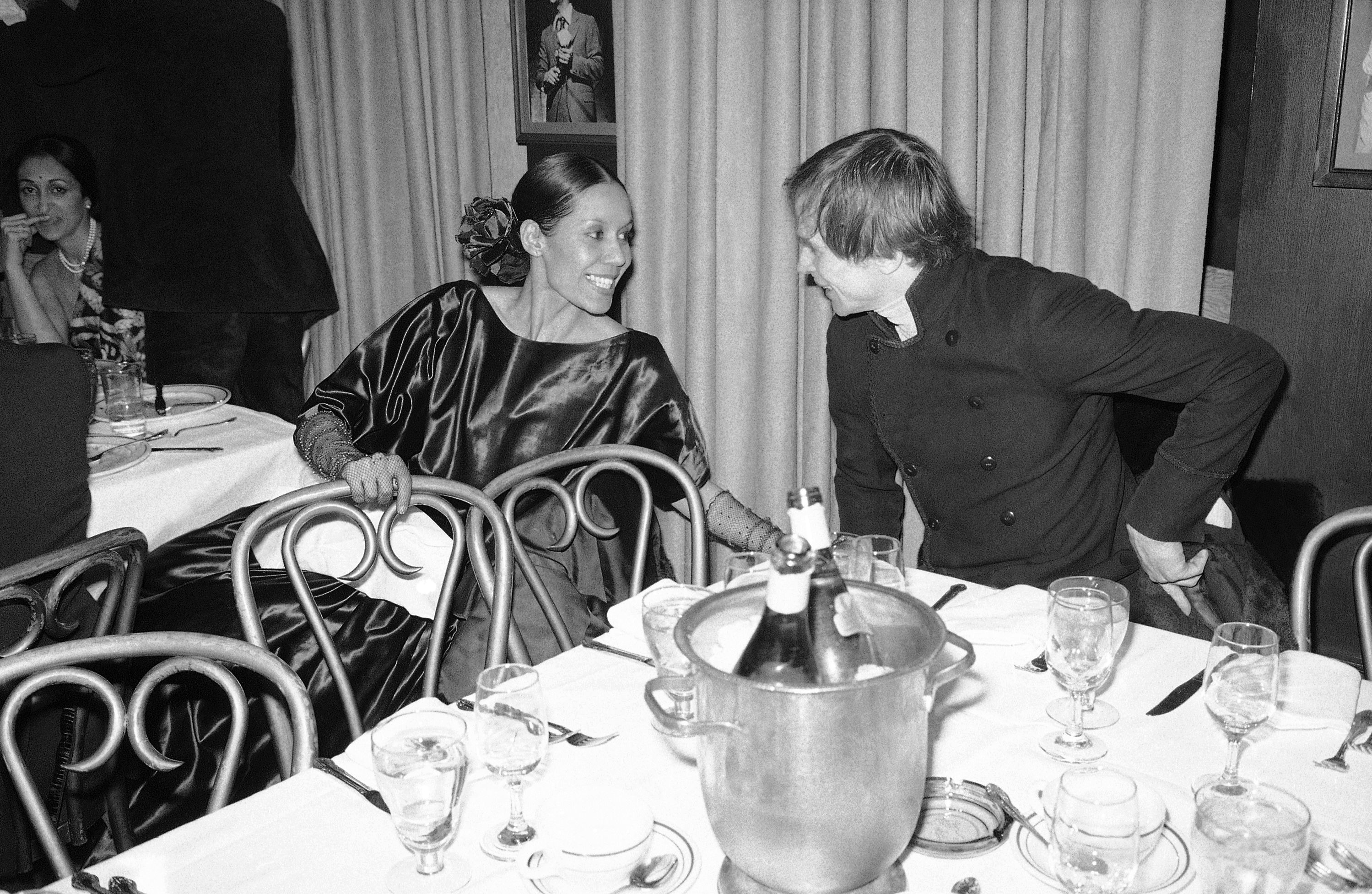 "FILE - In this March 1, 1977 file photo, dancer Carmen de Lavallade chats with Rudolf Nureyev after the opening night of ""Nureyev at the Uris"" at a party at Sardi's in New York. The John F. Kennedy Center for the Performing Arts on Thursday announced the recipients of the 2017 Kennedy Center Honors. They are: hip-hop artist LL Cool J, singers Gloria Estefan and Lionel Richie, television writer and producer Norman Lear and dancer Carmen de Lavallade. It's the 40th year of the awards, which honor people who have influenced American culture through the arts. (AP Photo/Carlos Rene Perez)"