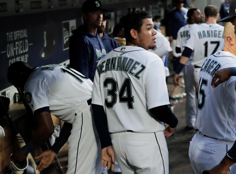 Seattle Mariners starting pitcher Felix Hernandez (34) walks in the dugout after the fourth inning of a baseball game against the Toronto Blue Jays, Thursday, Aug. 2, 2018, in Seattle. The Blue Jays won 7-3. (AP Photo/Ted S. Warren)