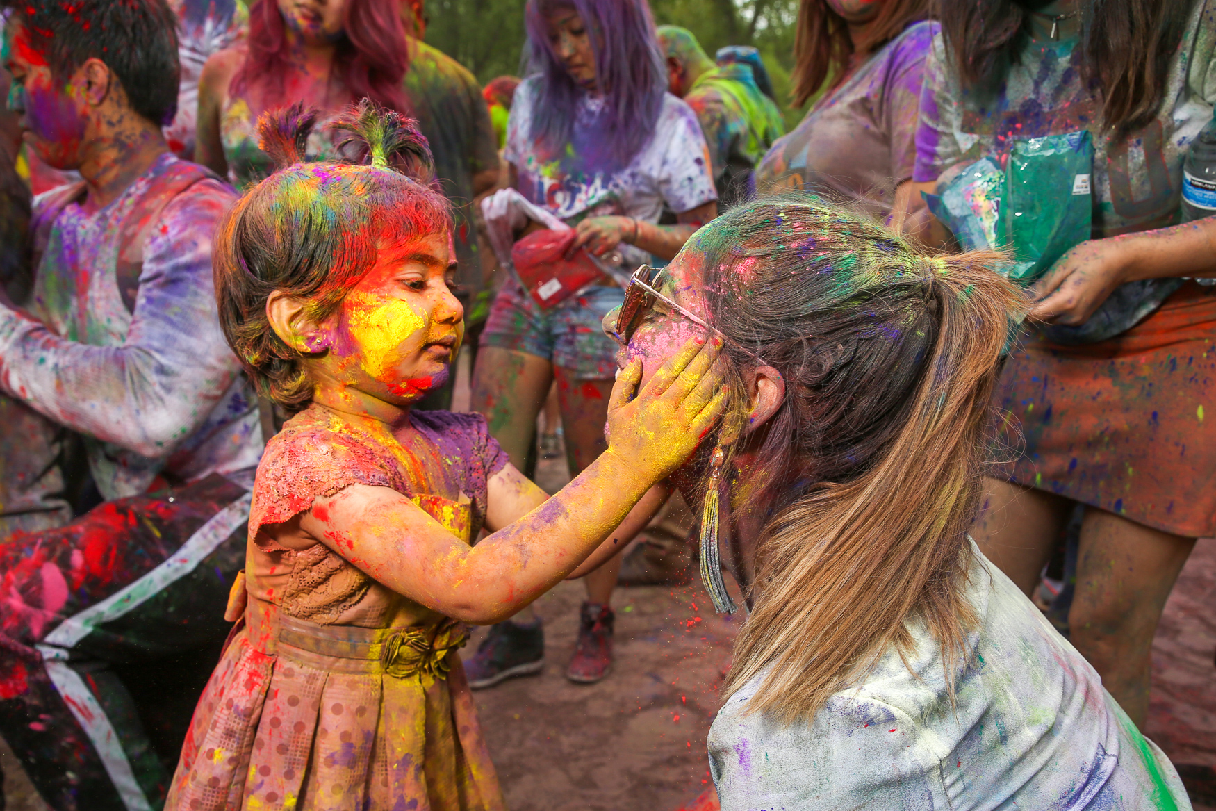 ISKCON of D.C., a local Hare Krishna Temple, celebrated Holi on May 6 by inviting people of all faiths to celebrate the annual spring holiday. Hundreds of worshipers and revelers gathered to throw colored powder, dance and snack on delicious Indian food. Holi is celebrated by Hindus and other religious groups, but the day is meant to unite loved ones through lighthearted fun. (Amanda Andrade-Rhoades/DC Refined)