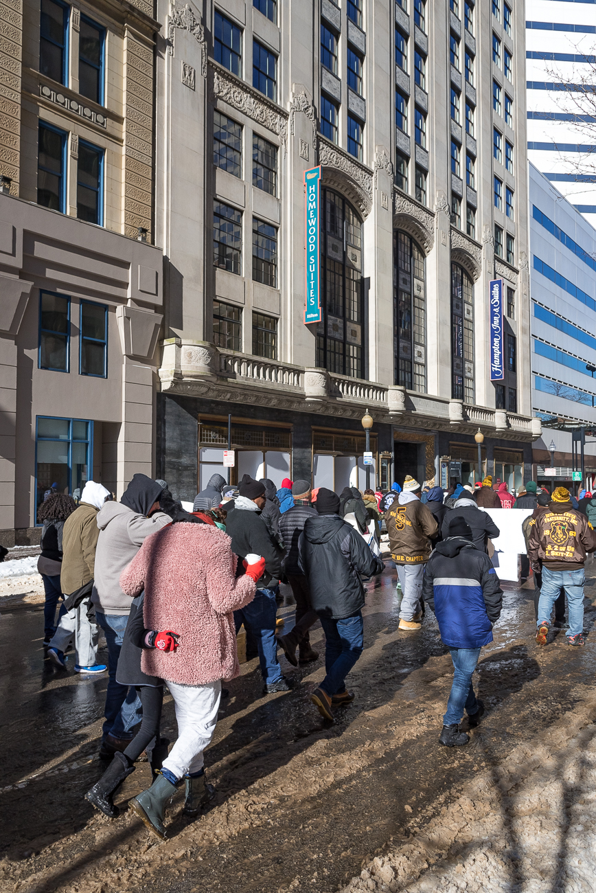 The 44th annual MLK March was held on Monday, January 21, 2019. After a breakfast at the National Underground Freedom Center in honor of reverend and civil rights activist Martin Luther King, Jr., a procession of people walked north on Vine Street to Fountain Square despite frigid temperatures. After an interfaith prayer service and brief series of speakers addressed the crowd, the group made their way further up Vine, west on Court Street, then north on Elm Street. The march concluded at Music Hall with MLK Day programming. / Image: Phil Armstrong, Cincinnati Refined // Published: 1.22.19